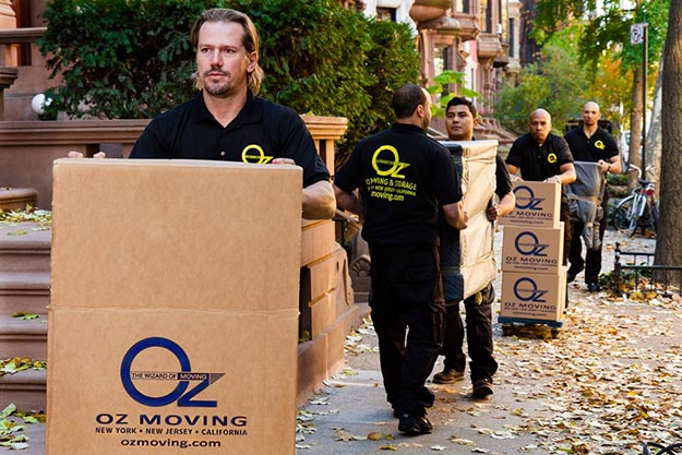 Oz movers carrying boxes