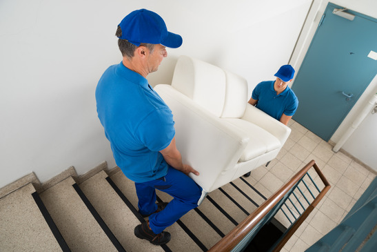 Moving a couch up a staircase